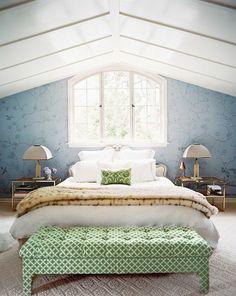 blue floral wallpaper + crisp white bedding + green tufted ottoman