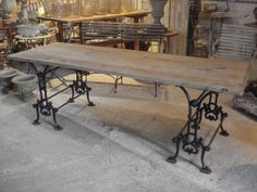 Cast iron base table.....LuV,LuV,LuV....I can do this with 2 matching antique sewing bases..... ;)