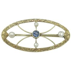 This stunning antique brooch is set with a gorgeous genuine blue Sapphire gemstone as well as lovely pearls in the North, South, East, West Edwardian Jewelry, Edwardian Era, Antique Jewelry, Victorian, Sapphire Gemstone, Blue Sapphire, Candy Boutique, Antique Brooches, North South
