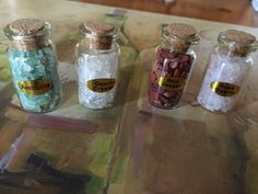 Even more miniature bottles filled with semi precious gemstones.