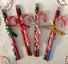 Simple and budget friendly. I made these as gifts for my daughter to give to her kindergarten classmates. What you'll need: Pencils Tape Ribbon Candy Canes