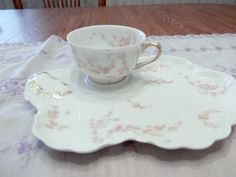 Limoges snack set is titled Norma by Haviland- Circa 1888-1930. $100.00, via Etsy.    I think I have something that matches this pattern - a tea cup maybe.