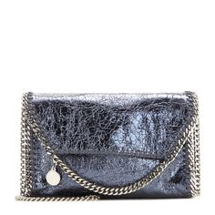 Stella McCartney - Falabella metallic shoulder bag - Stella McCartney's iconic 'Falabella' shoulder bag gets a metallic update this season. The signature chain detailing is kept a subtle gunmetal grey shade. The blue shade looks stunning next to an all black outfit after dark. seen @ www.mytheresa.com