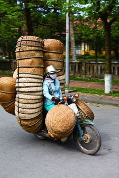 Andy Abercrombie and his wife can hardly believe the kinds of loads they see being hauled by bike around Hue, Vietnam -- as recording in his slideshow for Matador Abroad.