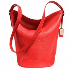 NWT Coach Red Duffle Shoulder Bag Pebble Leather Brand new red duffle leather bag from Coach. Style number F34474. Authentic. Never been used. Zip-top closure and fabrics lining. Approximately 15L by 14H by 9W. Comes from a smoke-free home. SOLD OUT. Coach Bags Shoulder Bags