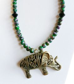 This a handmade necklace made using green glass beads and a bronze elephant charm. Available at NiikNakks on etsy.com. Thank you for looking!