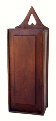 """17-1/2"""" l. X 5-1/4"""" w. X 4"""" d. 19th-c. walnut hanging candle box with dovetailed sides, a slide-lid top & a carved out heart from which the box can be hung on the wall. In very good condition with a warm patina.  There is a quarter size small carved circle on one side that does not go through to the inside & an inch long repair on the bottom side of the right lower panel.  Offered in July 2017 on 1stNLine for $595."""