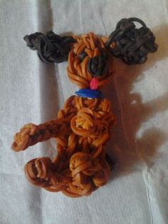 Tina Caldwell Wood Rainbow Loom FB page DOG I made my daughter. Based on the POODLE pattern by PGs Loomacy. Used petal pattern from HIBISCUS to make the ears!