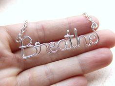 Breathe Necklace Silver Wire Wrapped Necklace Wire Word Jewelry Personalized Necklace Wire Wrap Jewelry Gifts under 20. $16.95, via Etsy.