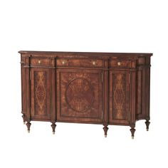 Concave Side Cabinet A fine mahogany and burl mahogany banded side cabinet, with three frieze drawers above corresponding oval panel and lozenge inlaid doors enclosing adjustable shelves, with concave sides, on turned legs with brass cappings. #furniture #cabinet #livingroom #newyork