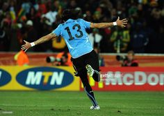 Sebastian Abreu of Uruguay celebrates scoring the winning penalty in the shoot out during the 2010 FIFA World Cup South Africa Quarter Final match between Uruguay and Ghana at the Soccer City stadium on July 2, 2010 in Johannesburg, South Africa.
