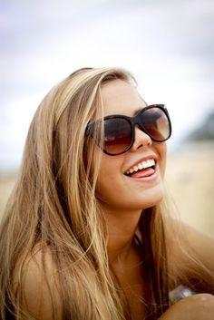 blonder hair, darker skin, tan lines, sunglasses. summer.