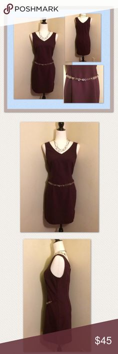 "My Michelle vintage burgundy sleeveless dress My Michelle gorgeous vintage burgundy sleeveless classic party dress. Size 11/12. This beautiful dress features a circular silver chain belt in the front and a zipper back. It's v-neck both in the front and back. Material is soft polyester. I'm 5'4"" and it comes a little above my knees. So pretty! In perfect vintage condition! This was only worn once and very well cared for. Vintage Dresses Mini"