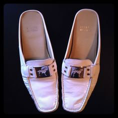 Stuart Weitzman These are  Stuart Weitzman's Dalmatian Collection White Slide On. In very good  condition and worn quite a bit! Silver hard wear on white patent leather Stuart Weitzman Shoes