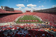 Attend college football game. Football at Camp Randall Stadium