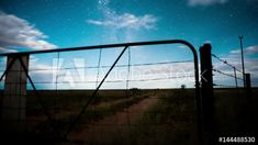 Stock Footage of Linear timelapse at night time with a dramatic moonlit landscape scene in the Karoo, through a rusted farm gate with scattered clouds available on request. Explore similar videos at Adobe Stock Farm Gate, Milky Way, Windmill, Stock Video, Geology, Night Time, Stock Footage, South Africa, Adobe