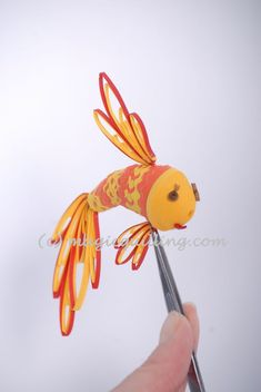 Goldfish. Today we show you how to create amazing fish in the art 3D Quilling, which wants to catch, perhaps, to think of each and their most cherished desires. Our fish can be hung on Christmas trees, and it will help to create an amazing tale in the house