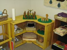 Our focal shelf (classroom #1). We have really oddly shaped rooms, so it had to be a corner shelf!