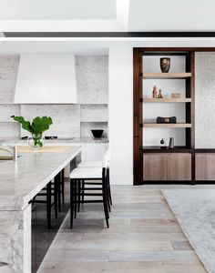 """Kitchen benchtop in White Fantasy marble and splashback in Carrara marble, both from [Artedomus](http://www.artedomus.com/
