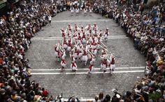 'Dantzaris' or Basque dancers perform the traditional sword dance during the celebration of the San Fermin de Aldapa Fiestas held in Pamplona, Navarra, Spain