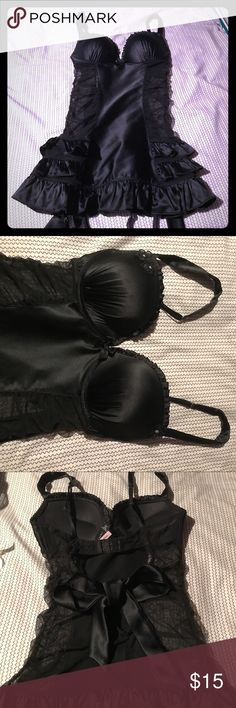 Victoria's sweet black lingerie Never worn black lingerie with mesh sides, built in underwire and ruffled skirt . Snap and tie closures in back Victoria's Secret Intimates & Sleepwear Bras