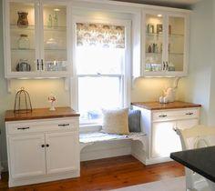 Love this storage/bench around the window in a kitchen.