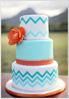 Wedding cake inspiration - maybe swap the chevron pattern out for waves?