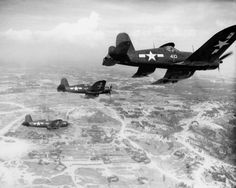 FG-1D Corsairs in flight over Okinawa (1945)