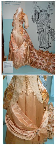 An 1888 evening gown made from peach silk brocade and Brussels lace.  It features a lovely train in back and a crystal brooch on the drape front overskirt.  The bodice is brilliantly fitted and looks so lovely with the high collar in back and numerous buttons down the basque front.