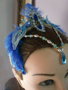 This amazing has piece has been crafted by a famous Brazilian artist. It is the Princess Florina head piece for younger dancers. Entirely hand-made realized with real swan feathers and Swarovski cryst