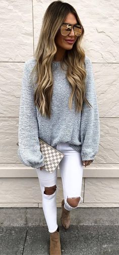 spring outfit idea_grey sweater + clutch + white ripped jeans + boots