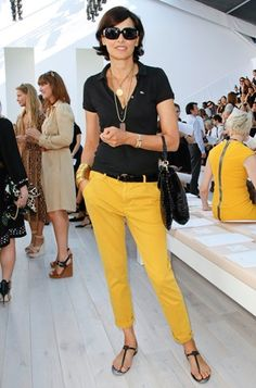 Ines de la Fressange: casual outfit black top, yellow pants.