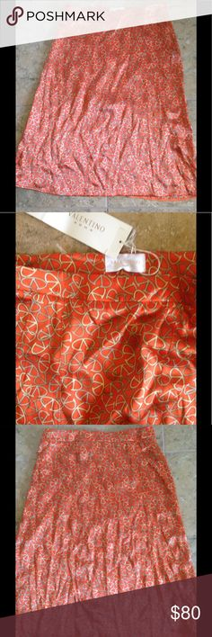 🔥🔥🔥🔥Valentino Roma Silk Skirt🔥🔥🔥🔥 🔥🔥🔥🔥Valentino gorgeous 100% silk skirt. In a deep orange color with gold V print. A made in Italy great quality skirt. It's also in excellent condition.🔥🔥🔥🔥 Valentino Roma Dresses Midi