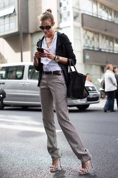 Via the Sartorialist. A cool approach to black and white dressing that won't have you being confused for a waiter...