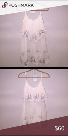 Free People Dress Beautiful floral beading design. Only worn once. NEW CONDITION. Free People Dresses Mini