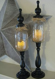 Love this idea! Mason jars, repurposed candlestick holders and fancy things on top. Love it!