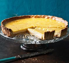 This dinner party dessert is a twist on a French tarte au citron, with citrus zest in the pastry - cheat with ready-made to save time
