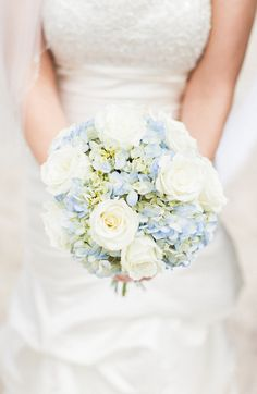 Blue hydrangeas and white roses are perfect for a beach wedding or summer wedding. By Kristen Lynne Photography. http://www.thebridelink.com/blog/2014/05/02/beach-wedding-in-ocean-isle-north-carolina-by-kristin-lynn-photography/