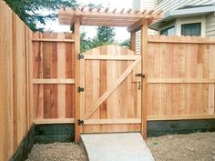 """""""dog eared"""" wood fence with rounded gate and arbor"""