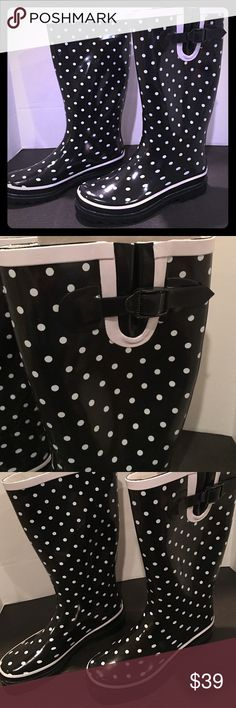 Black and White Polka Dotted Rain Boots Brand new Polka dotted Rain Boots. White trim. Black buckle. I will ship out next day in a separate box to avoid extra shipping charges. Shoes Winter & Rain Boots