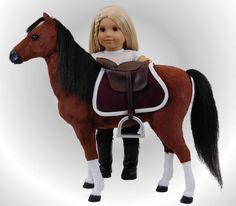 """Our wonderful chestnut quarter horse is sized perfectly for use with dolls like 18"""" American Girl Dolls. """"Sunny"""" the horse comes with a rich burgundy blanket trimmed in white. Perfect to ride or lead our elegant Victorian sleigh and saddle with saddle blanket sold separately. Designed and Manufactured by us, The Queen's Treasures"""