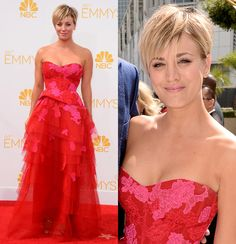 While lots of stars donned red at the Emmys, Kaley Cuoco-Sweeting made a small tweak to the trend, wearing a red and hot pink Monique Lhuill...