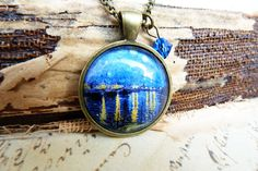 """Pendant with part of my favorite Van Gogh painting--not actually the famous """"Starry Night,"""" but his """"Starry Night Over the Rhone."""" (By wiccanstyle on Etsy)"""