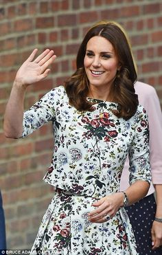 Now, that's a welcome! The crowds that had gathered to see Kate, ten deep, were held back amid tight security behind steel barriers