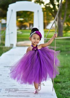baby girls feather headband eggplant berry purple silver glitter elastic mega bling rhinestone stunning ready to ship all sizes. $16.00, via Etsy.
