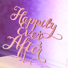 "Begin your fairy tale on a sweet note with a ""Happily Ever After"" cake topper"