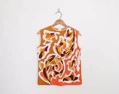 #vintage zio luigi signed top, op art top, orange op art print, sleeveless shell, knit shell, sleeveless sweater vest, #60s #mod top, #70s #hippie top m | #zioluigi #opart #opartprint #oparttop #opartblouse #60sfashion #60sstyle #60sclothing #60smod #modfashion #modstyle #70sfashion #70sstyle #70sclothing #fashion #vintagefashion #style #vintagestyle #clothing #vintageclothing #clothes #vintageclothes #trashyvintage #vintageshop #vintagestore #etsy #etsyvintage #etsyshop #etsystore @Etsy…