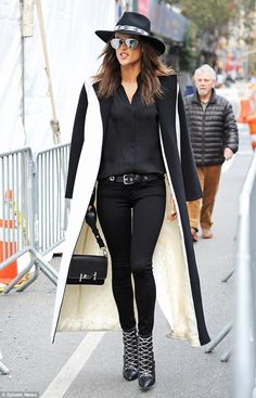 Supermodel style: Alessandra Ambrosio looked effortlessly stylish in a monochrome ensemble...