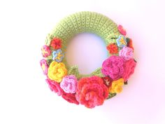 crochet wreath patterns to hang on door | Crochet door wreath, colorful with flowers, spring wreath, spring ... could make my own.