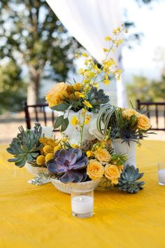 love this centerpiece of milk glass, yellow flowers and succulents